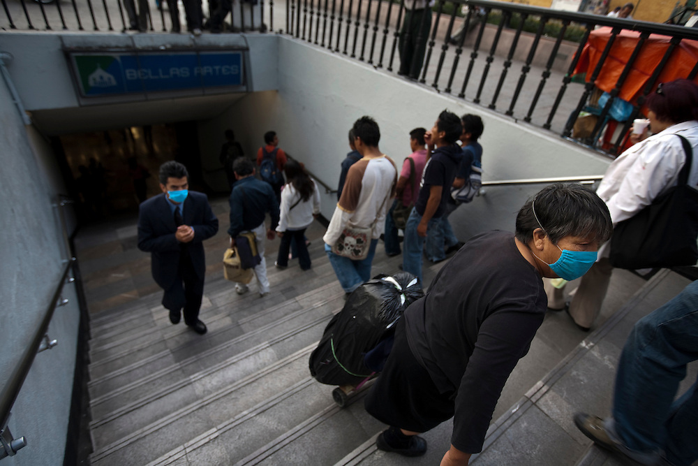 24 April 2009, Mexico City, Mexico--- Residents of Mexico City exit the metro wearing surgical masks to protect themselves from a deadly strain of Swine Flu that has alread killed 60 people and made 1008 sick. The Swine Flu which has also been found elsewhere in Mexico and the USA is extremely worrying to the WHO, and CDC who belive that it could cause a Flu Pandemic. The disease tends to kill young healthy people, which is common with a Pandemic Flu.  --- Image by © Trevor Snapp