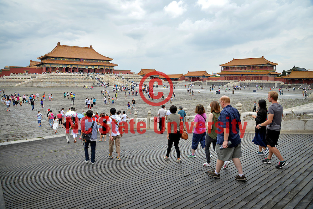 Tourists tour the Forbidden City in Beijing.