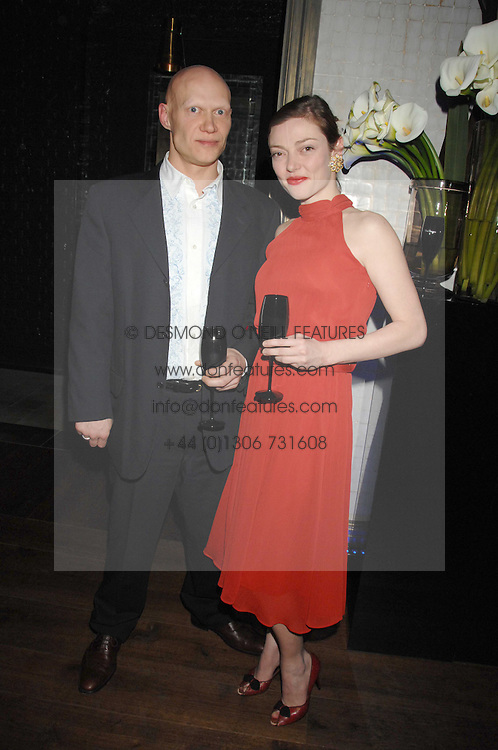 CAMILLA RUTHERFORD and DOMINIC BURNS at a party to launch the Dom Perignon OEotheque 1995 held at The Landau, Portland Place, London W1 on 26th February 2008.<br />