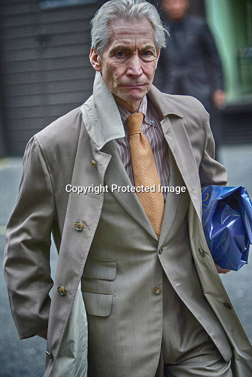 CHARLIE WATTS DOING SOME LIGHT SHOPPING IN THE WEST END