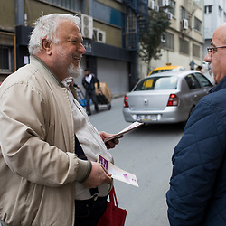Volunteer Hurriyet Demirhan, left, distributes flyers supporting the No vote on March 10, 2017 in the Istanbul district of Sisli.