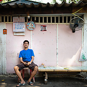Portrait of young Thai man in  Khlong Toei neighbourhood of Bangkok