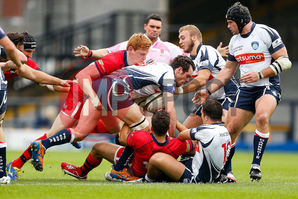 Yorkshire Carnegie Full Back David Mcllwaine is tackled by Bristol Outside Centre Jack Tovey - Photo mandatory by-line: Rogan Thomson/JMP - 07966 386802 - 14/09/2014 - SPORT - RUGBY UNION - Leeds, England - Headingley Carnegie Stadium - Yorkshire Carnegie v Bristol Rugby - Greene King IPA Championship.
