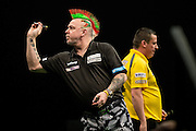 Peter Wright during his match with Dave Chisnall during the Premier League Darts  at the Motorpoint Arena, Cardiff, Wales on 31 March 2016. Photo by Shane Healey.
