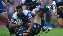Cape Town-180427 Damian de Allende of Stomers tackled by  Rebels player Jack Debreczeni  in a Super 15 match played at Newlands stadium.photograph:Phando Jikelo/African News Agency/ANA