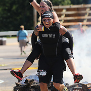 Jose and Mariah Vega and in action at the fire jump obstacle during the Reebok Spartan Race. Mohegan Sun, Uncasville, Connecticut, USA. 28th June 2014. Photo Tim Clayton