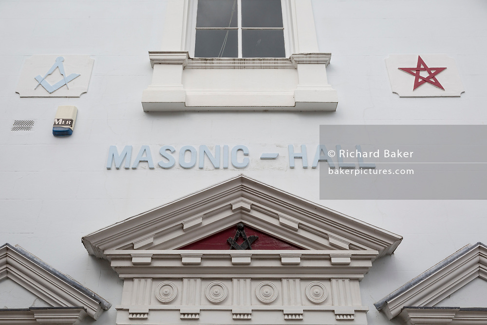 The exterior, architecture and Masons' symbols of a Masonic Hall, on 11th September 2018, in Brand Lane, Ludlow, Shropshire, England UK.