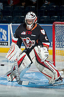 KELOWNA, CANADA - FEBRUARY 28: Brendan Burke #1 of Calgary Hitmen warms up in net against the Kelowna Rockets on February 28, 2015 at Prospera Place in Kelowna, British Columbia, Canada.  (Photo by Marissa Baecker/Shoot the Breeze)  *** Local Caption *** Brendan Burke;