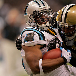 Nov 08, 2009; New Orleans, LA, USA; New Orleans Saints linebacker Scott Shanle (58) tackles Carolina Panthers running back Jonathan Stewart (28) during the third quarter at the Louisiana Superdome. The Saints defeated the Panthers 30-20. Mandatory Credit: Derick E. Hingle