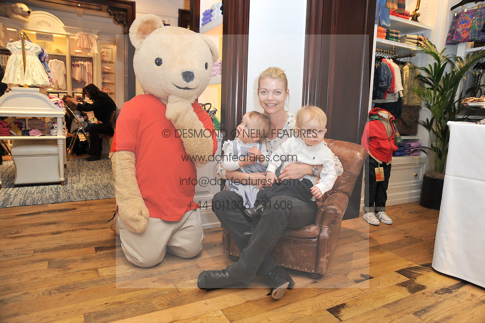 Sharky &amp; George and the RL Gang hosted a pre-Easter Holiday party in support of CLIC Sargent at the Ralph Lauren Children's store, 139/141 Fulham Road, London SW3 on 23rd March 2011.<br /> Image shows:- The COUNTESS OF MORNIGTON and her children MAE and DARCY with the Ralph Lauren Bear.