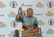 Food Network Star Guy Fieri attends Carnival's Summertime Beer-B-Que featuring food from his new Pig & Anchor Bar-B-Que Smokehouse, exclusively on Carnival Cruise Line, Wednesday, July 27, 2016, in New York.  (Diane Bondareff/ AP Images for Carnival Cruise Line)
