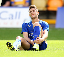 Leicester City's Andrej Kramaric holds his shin after a challenge from Mansfield Town's Scott Shearer - Mandatory by-line: Robbie Stephenson/JMP - 25/07/2015 - SPORT - FOOTBALL - Mansfield,England - Field Mill - Mansfield Town v Leicester City - Pre-Season Friendly