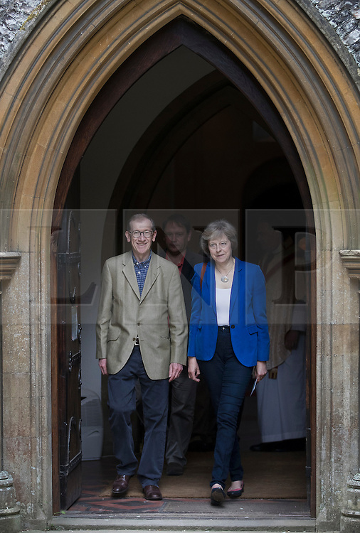 © Licensed to London News Pictures. 17/07/2016. Reading, UK. Prime Minister Theresa  May and her husband Philip attend church in her constituency. Mrs May has spent the first few days as Prime Minister assembling her cabinet.Photo credit: Peter Macdiarmid/LNP