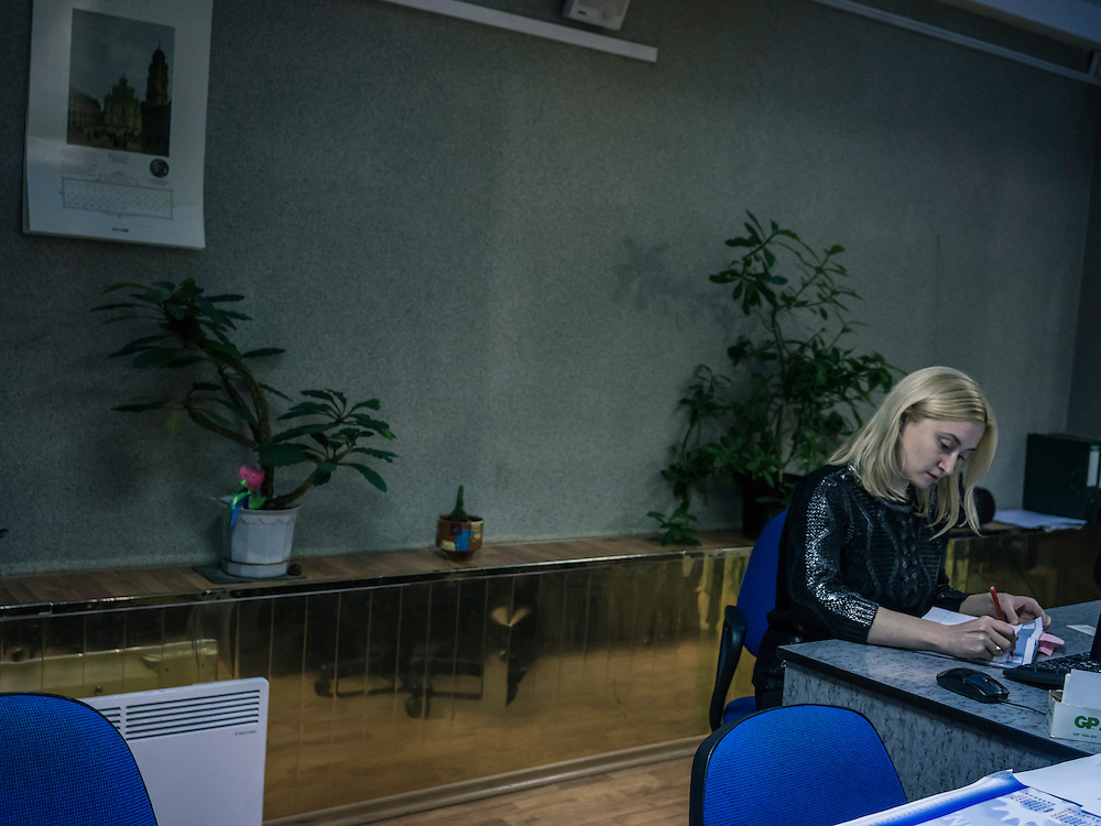 Securities trader Anna Pirozhnikova works at the Belarus Stock Exchange on Monday, November 23, 2015 in Minsk, Belarus.