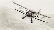 1933 Waco UIC arriving home at WAAAM.