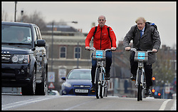 The London Mayor Boris Johnson and Andrew Gilligan on Barclays Bikes on the Wandsworth Bridge as he expands the Barclays Cycle Hire to Wandsworth, South West London, United Kingdom. Friday, 13th December 2013. Picture by Andrew Parsons / i-Images