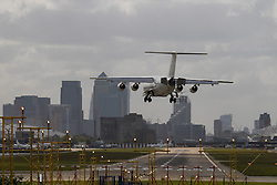 "London City Airport, May 5th 2015. With crosswinds gusting at up to 45 mph, several planes attempting to land at London City Airport have to abort their landings and do a ""go-round"" whilst others endured rough landings.  PICTURED: With the wind crossing the runway from left to right, planes crab in sideways before straightening up on touchdown."