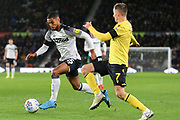 Derby County defender Max Lowe (25) evades a tackle by Millwall midfielder Jed Wallace (7) during the EFL Sky Bet Championship match between Derby County and Millwall at the Pride Park, Derby, England on 14 December 2019.