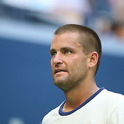 2017 U.S. Open Tennis Tournament - DAY FOUR. Mikhail Youzhny of Russia in action against Roger Federer of Switzerland during the Men's Singles round two match at the US Open Tennis Tournament at the USTA Billie Jean King National Tennis Center on August 31, 2017 in Flushing, Queens, New York City. (Photo by Tim Clayton/Corbis via Getty Images)