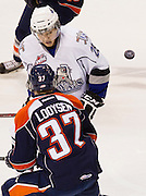 Victoria Royals forward Brandon Fushimi and Kamloops Blazers forward Nathan Looysen eye the puck during the first period at Save-on-Foods Memorial Centre in Victoria, B.C., on Saturday March 9, 2014. Photograph by: KEVIN LIGHT.