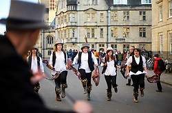 "© Licensed to London News Pictures. 01/05/2018. Oxford, UK. Morris dancers in dress dance near Hertford Bridge, often called ""the Bridge of Sighs""  in Oxford, Oxfordshire as part of May Day celebrations. Students were again prevented from jumping from Magdalen Bridge in to the river, which has historically been a tradition, due to injuries at a previous years event . Photo credit: Ben Cawthra/LNP"