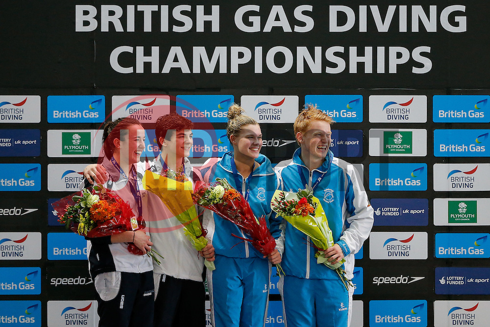 Runners up Clare Cryan and Ross Haslam of Sity of Sheffield Diving Club and Winners Grace Reid and James Heatly of Edinburgh Diving Club celebrate on the podium for the new for 2015 Mixed 3m Synchronised Springboard Competition - Photo mandatory by-line: Rogan Thomson/JMP - 07966 386802 - 20/02/2015 - SPORT - DIVING - Plymouth Life Centre, England - Day 1 - British Gas Diving Championships 2015.