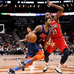 Feb 14, 2019; New Orleans, LA, USA; Oklahoma City Thunder forward Paul George (13) drives past New Orleans Pelicans forward Darius Miller (21) during the second quarter at the Smoothie King Center. Mandatory Credit: Derick E. Hingle-USA TODAY Sports