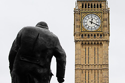 © Licensed to London News Pictures. 29/03/2017. London, UK. Big Ben strikes 12:20pm, the exact time that Article 50 is formally triggered, with a letter bearing the Prime Minister's signature being delivered by Sir Tim Barrow, the UK's permanent representative in Brussels, to the European council president, Donald Tusk, to provide notification of Britain's intention to leave the European Union. Photo credit : Stephen Chung/LNP