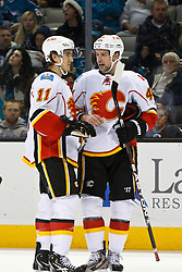 Jan 17, 2012; San Jose, CA, USA; Calgary Flames center Mikael Backlund (11) talks with defenseman Chris Butler (44) during a stoppage in play against the San Jose Sharks during the first period at HP Pavilion. San Jose defeated Calgary 2-1 in shootouts. Mandatory Credit: Jason O. Watson-US PRESSWIRE