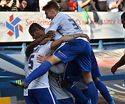 Nathan Cameron is mobed by his team mates after his opener during the Sky Bet League 1 match between Bury and Port Vale at Gigg Lane, Bury, England on 19 September 2015. Photo by Mark Pollitt.