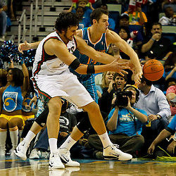 October 27, 2010; New Orleans, LA, USA; New Orleans Hornets power forward Jason Smith (14) knocks the ball away from Milwaukee Bucks center Andrew Bogut (6) of Australia during the second half at the New Orleans Arena. The Hornets defeated the Bucks 95-91.  Mandatory Credit: Derick E. Hingle