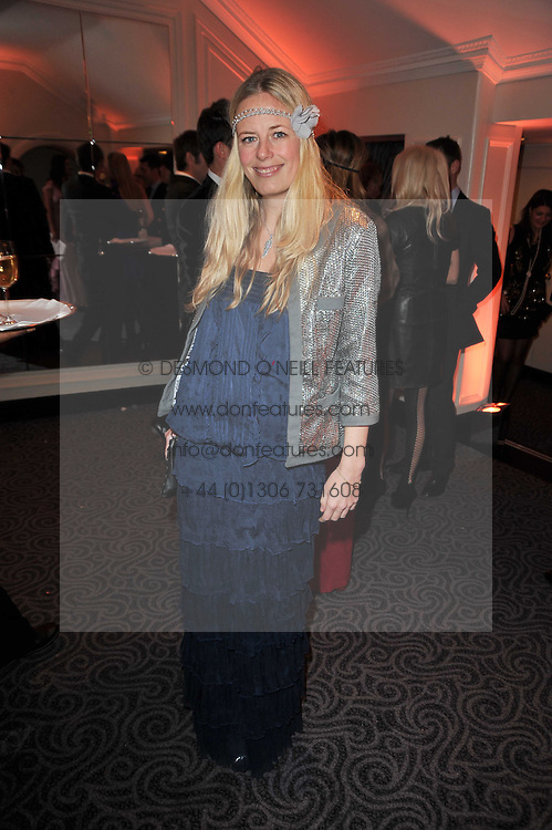 ASTRID HARBORD at Quintessentially's 10th birthday party held at The Savoy Hotel, London on 13th December 2010.