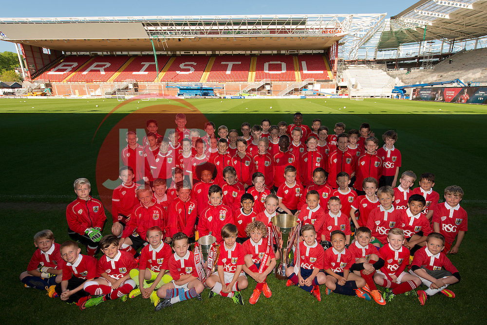 Players from Bristol City Academy pose with the Johnstone's Paint Trophy and Sky Bet League One Trophy  - Photo mandatory by-line: Dougie Allward/JMP - Mobile: 07966 386802 - 12/05/2015 - SPORT - Football - Bristol - Ashton Gate Stadium - Bristol City Academy
