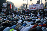 Cairo, Egypt, Dec, 01, 2012 - Followers of the Muslim Brotherhood and Islamist groups hold evening prayers during a demonstration in support of Egyptian President Mohamed Morsi near Cairo University. Saturday's demonstration was organized by Morsi's Muslim Brotherhood backers in order to counter protests against Morsi's declaration of last week that gave him almost unlimited power. (Photo by Miguel Juarez Lugo)