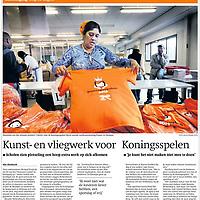Nederland, Diemen , 17 april 2013..Sharmila van der stroom, werkzaam bij sociaal werkplaats Panter in diemen sorteert oranje shirts voor de koningsspelen..Ter ere van de troonswisseling worden op 26 april de Koningsspelen gehouden. Duizenden scholen in het land doen mee aan deze landelijke buitensport- en speldag. Alle kinderen die meedoen gaan die dag gekleed in een speciaal oranje T-shirt. Pantar Amsterdam kreeg de opdracht om deze shirts te verzorgen..Trouw, 18 april 2013