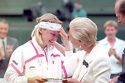 File photo dated 03-07-1993 of The Duchess of Kent comforts Jana Novotna as she presents her with the runner up trophy on centre court at Wimbledon. Novotna lost 6-7 6-1 4-6 to defending champion Steffi Graf.