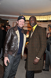 Left to right, SCOT YOUNG and OZWALD BOATENG at the Inspiring Morocco launch held at Harrods, Knightsbridge, London on 3rd November 2011.