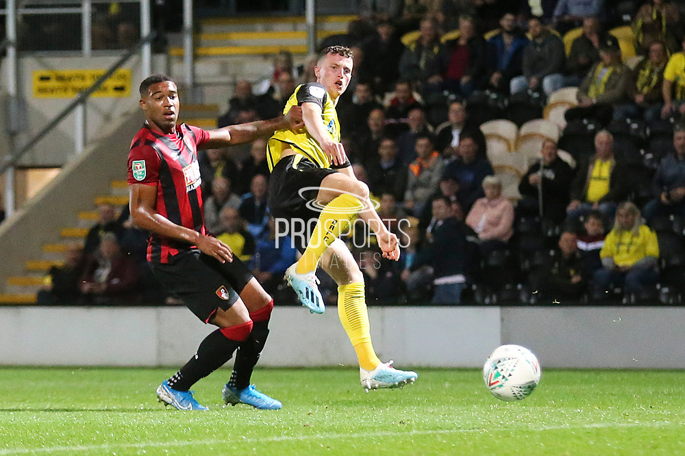 Burton Albion forward Nathan Broadhead (9) shoots at goal and his shot is saved by Bournemouth goalkeeper Mark Travers (42) during the EFL Cup match between Burton Albion and Bournemouth at the Pirelli Stadium, Burton upon Trent, England on 25 September 2019.
