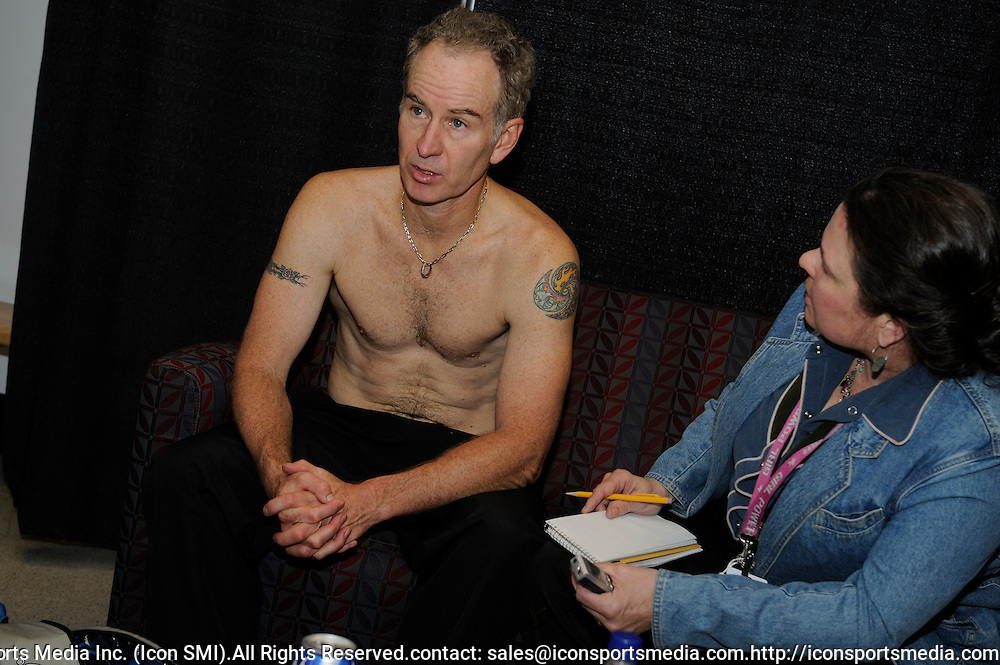 04 May 2008: John McEnroe at a post match interview with Barbara Matson of the Boston Globe in the locker room.   McEnroe won his first ever title on the Outback Champions Series at the Champions Cup Boston rallying from a set down to defeat fellow American Aaron Krickstein 5-7, 6-3, 10-5 (Champions Tie Break) in the championship match at the Agganis Arena, Boston, MA.