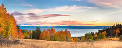 """Aspens Above Lake Tahoe 4"" - Panoramic photograph of yellow, orange, red, and green fall colored aspens above a blue Lake Tahoe, taken at sunset."