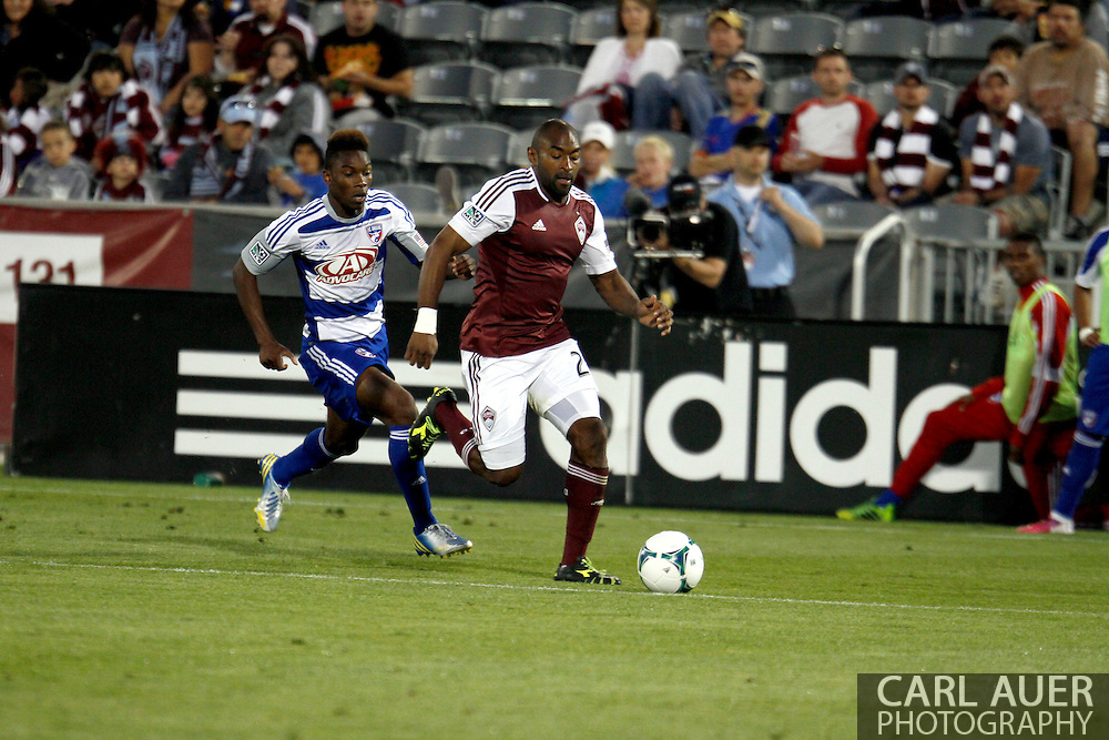 June 1st, 2013 - Colorado Rapids defender Marvell Wynne (22) attempts to keep the ball away from FC Dallas forward Fabian Castillo (11) in the second half of action in the MLS match between FC Dallas and the Colorado Rapids at Dick's Sporting Goods Park in Commerce City, CO