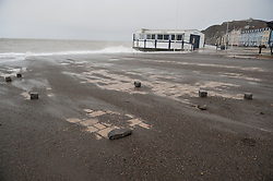 © London News Pictures. 01/02/2014. Aberystwyth, UK.  Damage to tiling on the seafront. Waves crash on to the seafront at Aberystwyth in Wales where locals are braced for further storms battering the coastline. The seafront at Aberystwyth was badly damaged by strong storm weather just a few weeks ago. Photo credit: Keith Morris/LNP