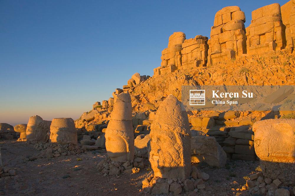 Statue of head at sunrise on the eastside of the mountain, Mt. Nemrut, Turkey