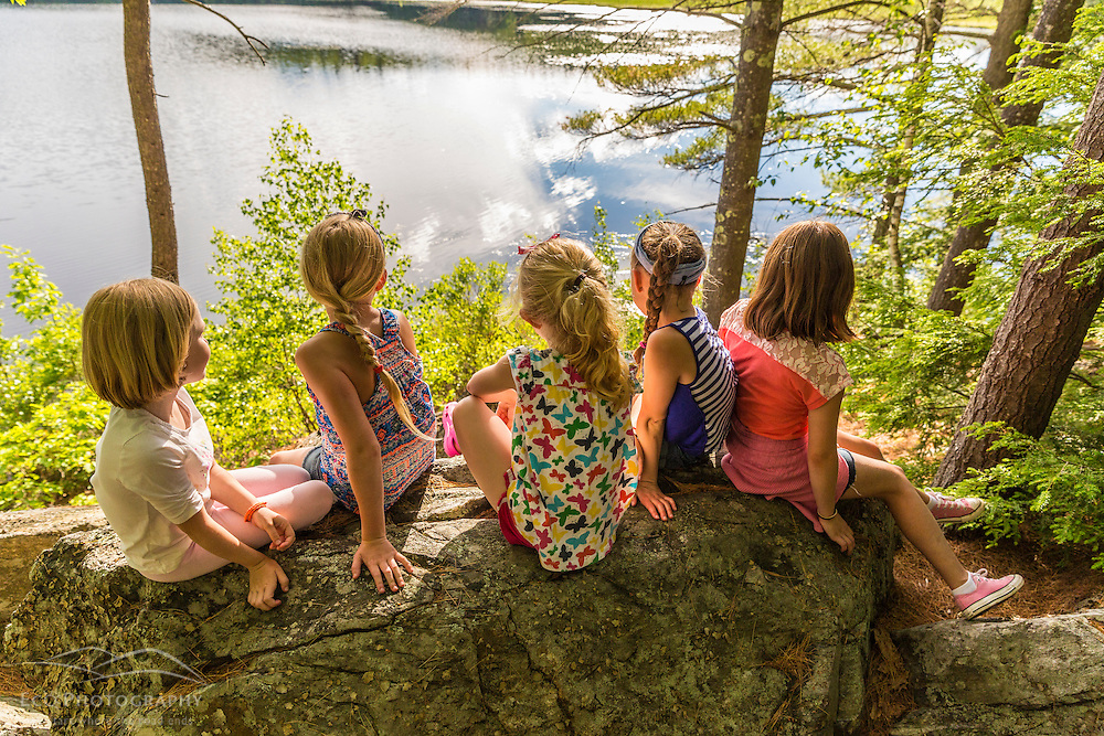 Five girls on a rock overlooking Page Pond in Meredith, New Hampshire.