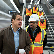 December 12, 2016 - New York, NY :  New York State Governor Andrew M. Cuomo, in brown jacket at left, is accompanied by Charlie Hall, construction manager of the project for Parsons Brinckerhoff, second from left, as they walk through the 96th Street Second Avenue subway station on Monday morning. After years of delays, the new second avenue subway line is nearing completion. The governor visited the soon-to-open second avenue subway project on Monday morning with this photographer and New York Times reporter Emma G. Fitzsimmons.  CREDIT: Karsten Moran for The New York Times