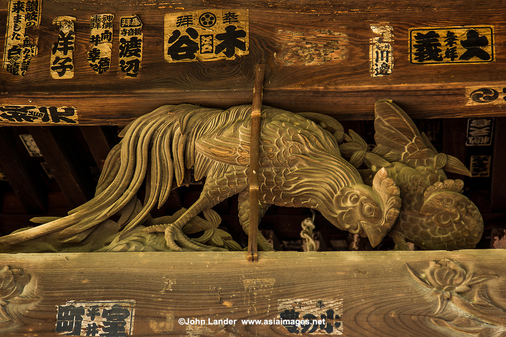 Temple wood carving at Shidoji -the 86th temple in the Shikoku Pilgrimage Buddhist trail.  Shido-ji is one of the more important temples along the henro pilgrims trail as it is towards the end of the long journey only two temples from the end of the trek.