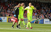 Harry Worley is helped from the field during the Sky Bet League 2 match between York City and Hartlepool United at Bootham Crescent, York, England on 15 August 2015. Photo by Simon Davies.