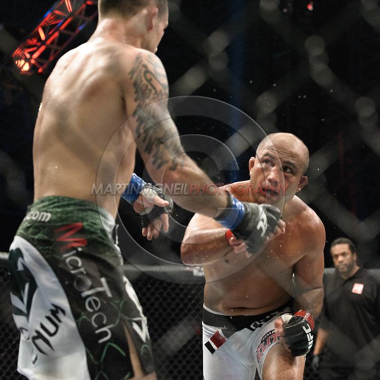 "ABU DHABI, UNITED ARAB EMIRATES, APRIL 10, 2010: Frankie Edgar (green/white shorts) and BJ Penn (white trunks) are pictured at ""UFC 112: Invincible"" inside Ferari World, Abu Dhabi on April 10, 2010"