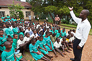 Andrew Kaggwa the community nurse from Bwindi Community Hospital leads a health education and nutrition training session with classes P 3,4,5,6,7 at Nyamiyaga primary school. As part of the outreach programme they cover 32 primary schools and 5 secondary schools in the region as well as many communities. The main Bwindi Community Hospital is in Buhoma village on the edge of the Bwindi Impenetrable Forest in Western Uganda. It serves around 250,000 people from the surrounding area.