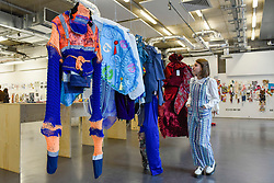 "© Licensed to London News Pictures. 11/05/2017. London, UK.  Colourful garments on display at an exhibition called ""Up and Coming"", in Granary Square King's Cross, featuring works by Central Saint Martins foundation students.   Photo credit : Stephen Chung/LNP"